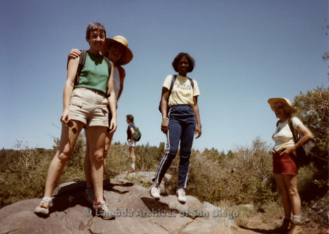 P008.089m.r.t Laguna Mountains 1984: Margaret Lewis, Mary Russell, and other women standing on a large rock