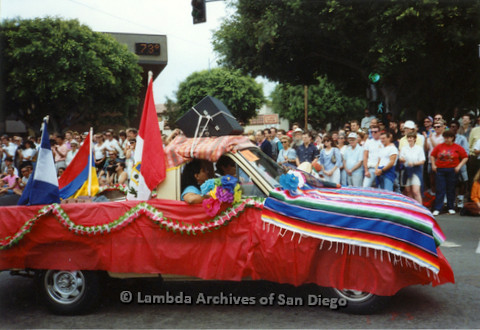 P018.077m.r.t San Diego Pride Parade 1991: Car decorated with Latin American flags