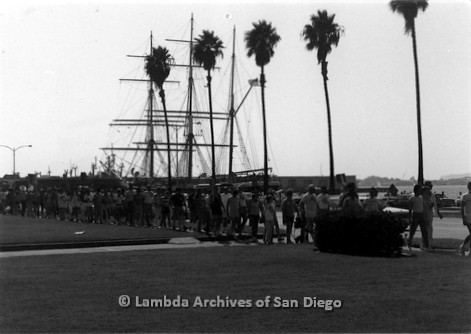 P116.029m.r.t San Diego Walks For Life 1986: Walkers on sidewalk passing the Star of India tallship