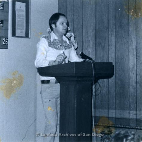 P355.072m.r.t MCC Oceanside Benefit 1976: Man speaking at the podium