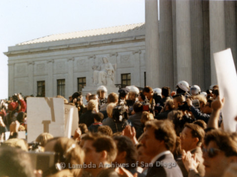P019.253m.r.t Second March on Washington 1987: People standing on the steps of the Capitol Building with police barricade in background
