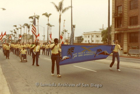 1982 - San Diego Lambda Pride Parade, 'Gay Men's Chorus of Los Angeles' Contingent members carry their banner as the group marches up the Pride Parade route toward Hillcrest.