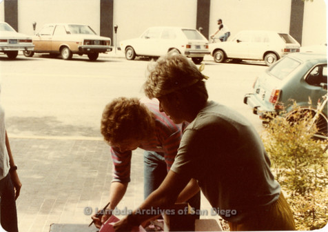 Blood Sisters blood drive, 1983: Volunteer checking in at the registration desk outside Blood Bank