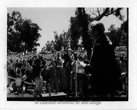 1977 - San Diego Lambda Pride Rally: Pride Parade Grand Marshall, Jess Jessop speaking at the Rally, held on the west end of Balboa Park.