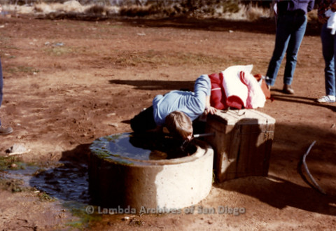 P008.003m.r.t Cuyamaca Fire Roads 1983: Diane F. Germain drinking from the horse trough