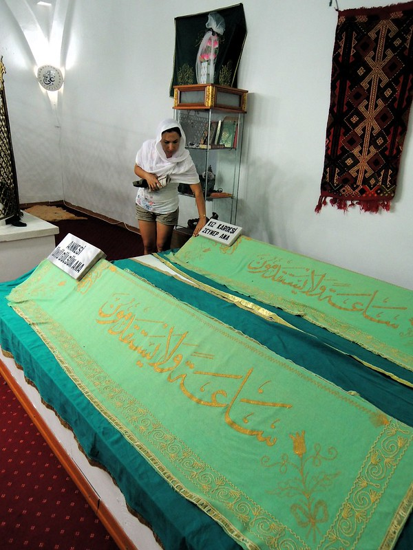 An Alevi praying at Abdal Musa's tomb by bryandkeith on flickr