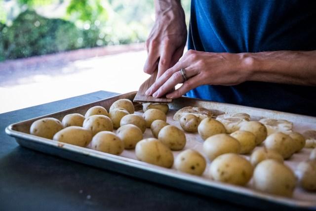 use the back of a spatula to smash the potatoes