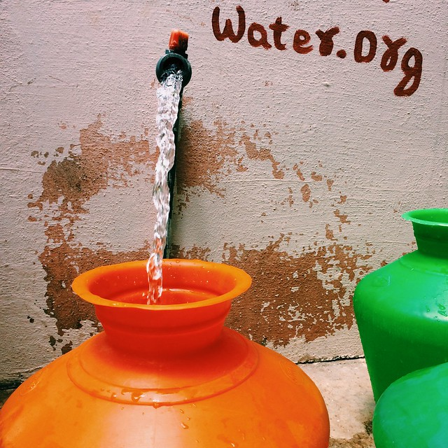 Safe water flows from a waterpoint in Kodihalli village, India
