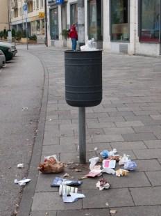small man on spring loaded bin