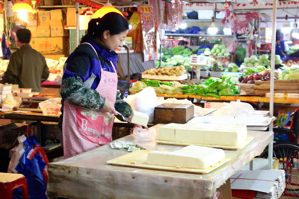 Fresh Tofu at the Market | Here a vendor at the ...