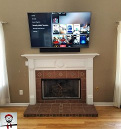 components concealed lg tv and sony soundbar fireplace mounted wire free power outlet relocated components concealed [ 819 x 1024 Pixel ]