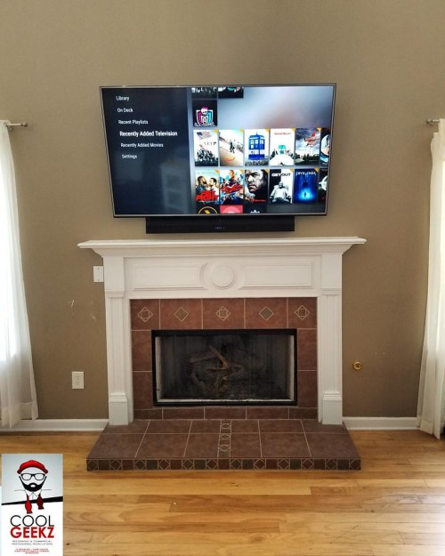 small resolution of components concealed lg tv and sony soundbar fireplace mounted wire free power outlet relocated components concealed