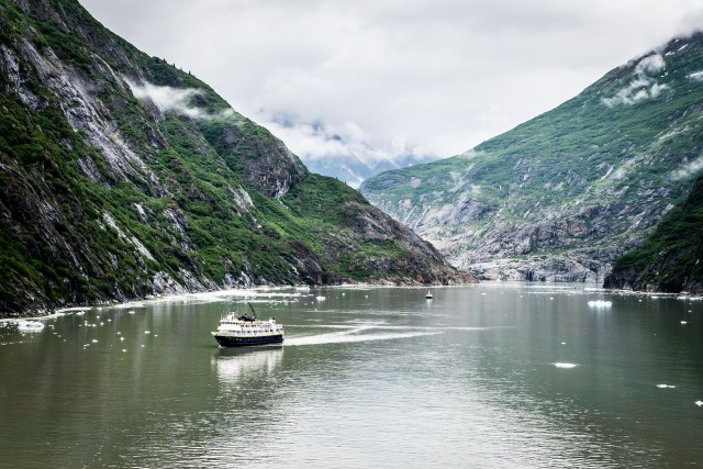 the fjord is lush, green, and filled with waterfalls