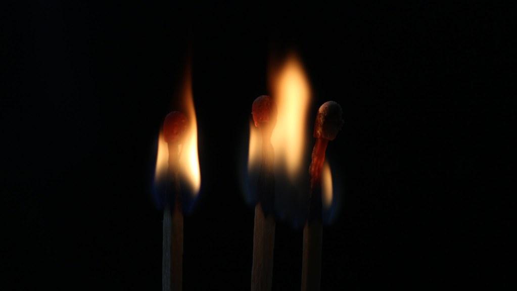 three matches on fire