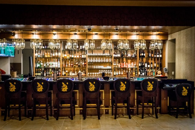 one of several fully-stocked bars at the Lucky Dragon