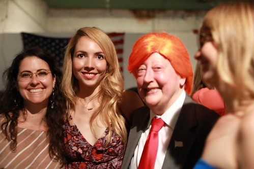 "Maya Suess, Emireth Herrera, Martha Wilson (impersonating Donald Trump), Christina Freeman  <a href=""https://www.artforum.com/slant/id=64752"" rel=""nofollow"">www.artforum.com/slant/id=64752</a>  MARTHA WILSON Performance on July 6    ""Martha Does Donald"" is a 10-minute impersonation of Donald Trump by Martha Wilson. Martha Wilson is a pioneering feminist artist who during the past four decades has created innovative photographic and performance works that explore her female subjectivity through role-playing and ""invasions"" of other people's personae.  She began impersonating political figures in 1982 with Alexander Haig, followed by Nancy Reagan, Barbara Bush, Tipper Gore, and now Donald Trump."