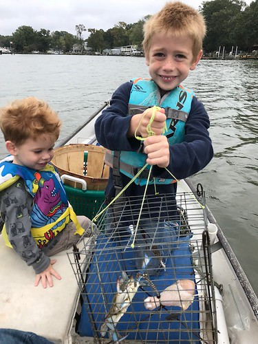 Photo of Two boys with their crab traps