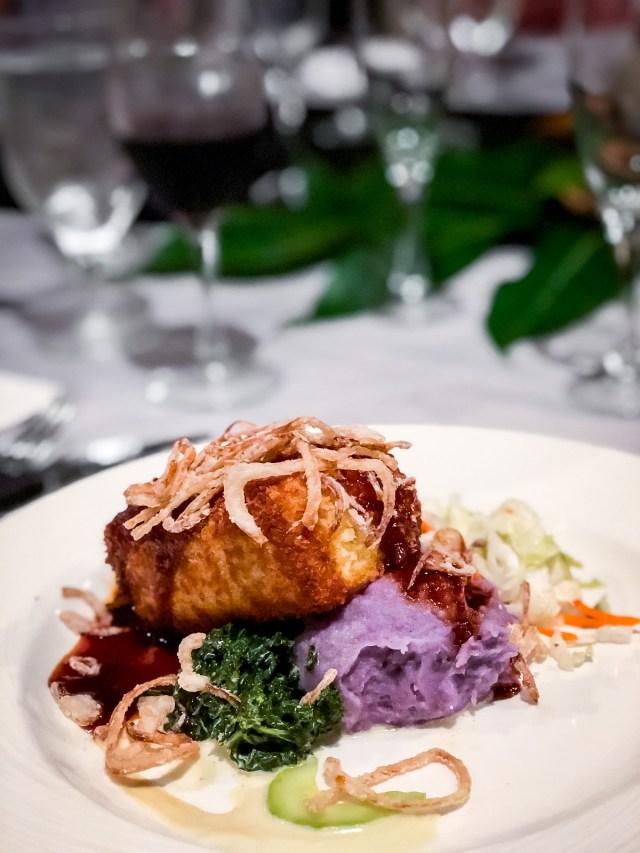 grilled huli huli tofu on a bed of bright purple mashed sweet potatoes