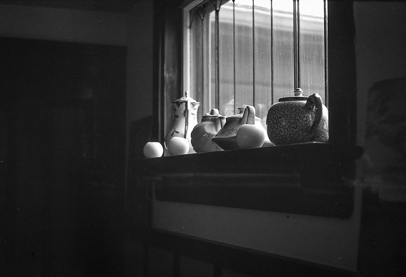Katherine's teapots, dining room, window ledge, Rockland, Maine, FED 4, Industar 26 (50mm, F2.8), Ilford FP4+, Moersch Eco Film Developer, 10.21.17