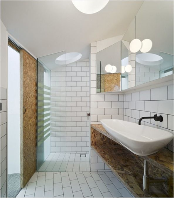 small-apartment-bathroom-designs-white-wooden-varnished-vanity-cabinet-dark-espresso-cabinet-towel-rack-cozy-corner-white-bathtub-white-pedestal-sink-including-arched-faucet-yellow-creative-wall-rack