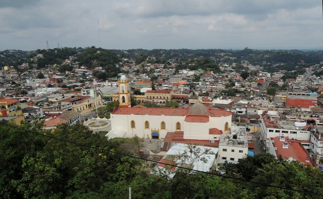 That's Papantla.  Just to the left of the church is the pole for La Danza de los Voladores and on the other side of the pole and the church is the main square. by bryandkeith on flickr