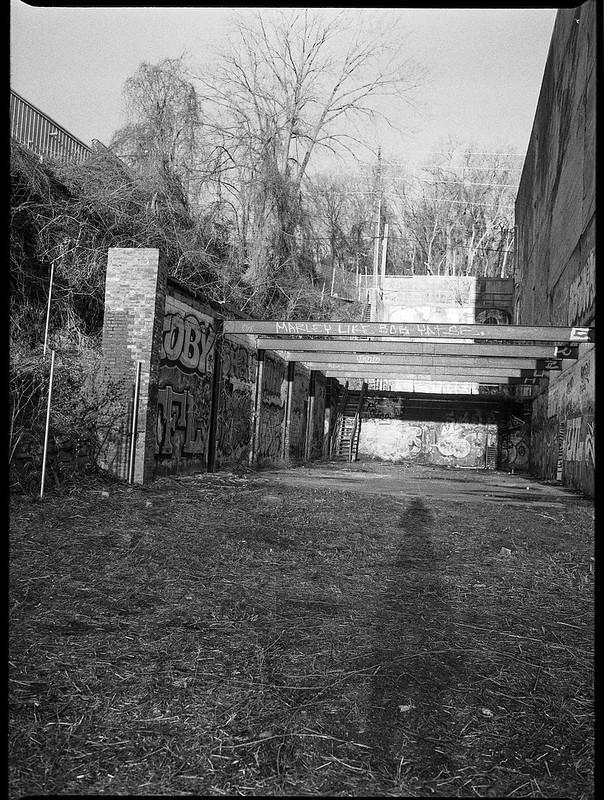 photographer's shadow, urban landscape, architectural remnants, River District, Ashevile, North Carolina, Mamiya 645 Pro, mamiya sekor 45mm f-2.8, Bergger Pancro 400, Ilford Ilfosol 3 developer, 1.5.19