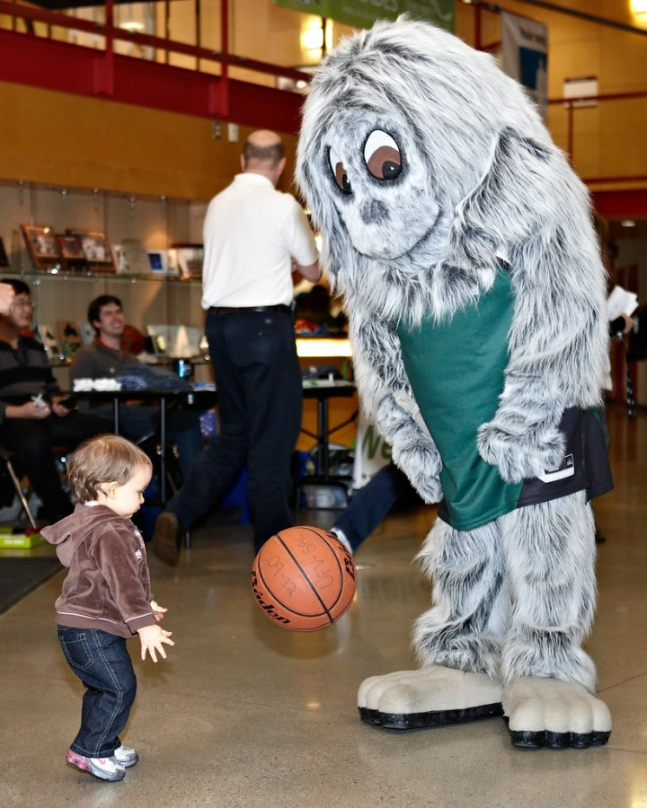 Sasq 'ets with a young fan | The Cascades mascot, Sasq 'ets,… | Flickr