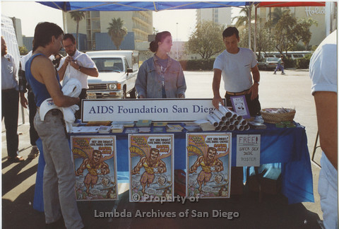 P001.122m.r.t AIDS Walk 1991: AIDS Foundation San Diego Booth with Safe Sex Dude poster