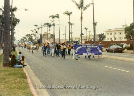 1982 - San Diego Lambda  Pride Parade, (M.C.C.) Metropolitan Community Church San Diego Contingent holds their banner as they march up 6th. avenue at the west end of Balboa Park toward Hillcrest.