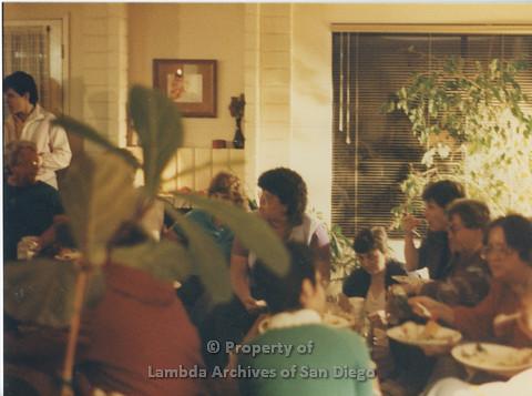 Alix Dobkin Concert,1985 in the home of Carol Cianfarani: Audience members enjoying refreshments during the reception for Lesbian, Feminist, Jewish, Folk Singer - Alix Dobkin.