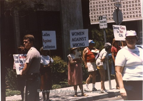 June 1985 - The 'Future Former Fundy Fighters' (4-F's) and 'Ladies Against Women' Founded by Gail Ann Williams, which is a joke group spoofing anti-feminist politics during Reagan presidency, create peaceful, safe space between Lambda Pride Parade Conting