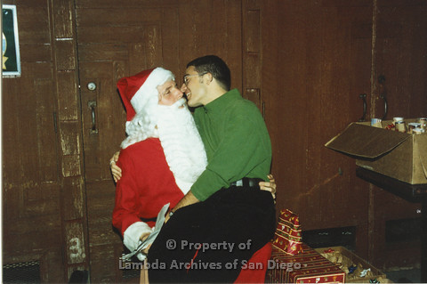 P001.301m.r.t X-mas:man in green sweater sitting on Santa's lap