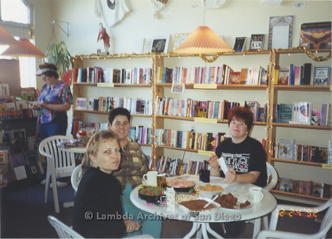 P167.088m.r.t Paradigm Women's Bookstore: Women inside bookstore enjoying what appears to be Christmas Eve dinner