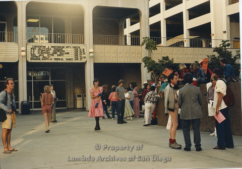P024.115m.r.t Myth California Protest, San Diego, June 1986: shot of crowd, woman in the center in a pink dress