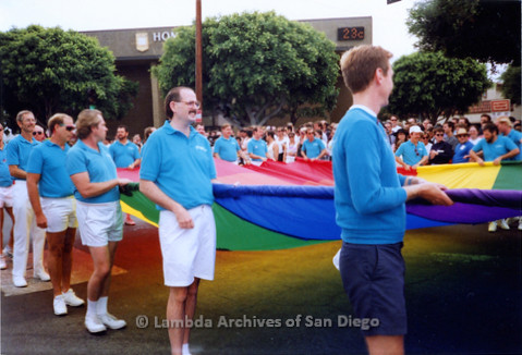 P018.057m.r.t San Diego Pride Parade 1991: Men carrying the rainbow flag