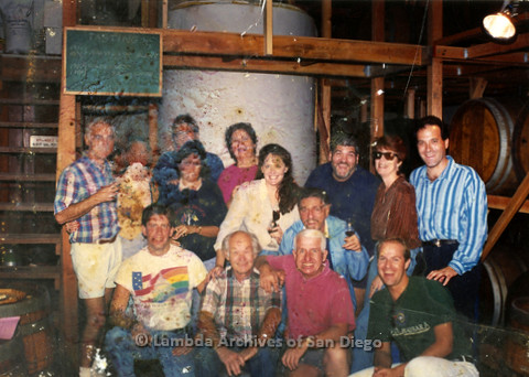 P099.065m.r.t Weathered group photo of men and women at a wine tasting, Rusty Rawnsley kneeling in front (pink shirt), Maurice Thimot (?) at far left