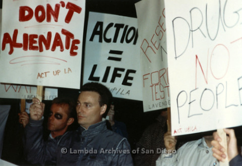 "P019.353m.r.t Los Angeles ""Die In"" 1988: Group of people holding protest signs"