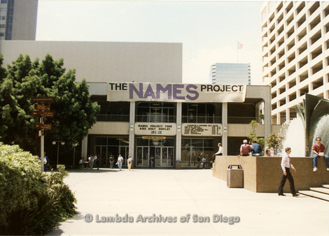 """P019.201m.r.t AIDS Quilt at San Diego Golden Hall 1988: """"The NAMES Project"""" banner hanging outside Golden Hall building"""