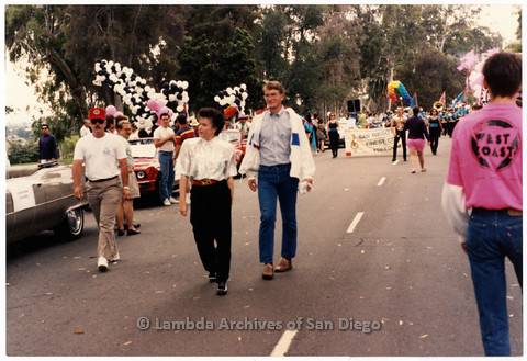 P201.036m.r.t San Diego Pride Parade 1991: Mayor Maureen O'Connor and Ben Dillingham walking down middle of street