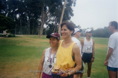 P263.018m.r.t Front Runners and Walkers of San Diego at 1998 Mud Pride: Two women smiling at the camera.