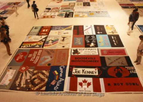 P019.188m.r.t AIDS Quilt at San Diego Golden Hall 1988: People walking around the AIDS Quilt exhibit