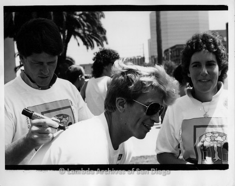 P116.109m.r.t San Diego Walks for Life 1987: Gordon Thomson signing a person's shirt