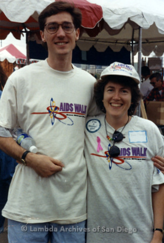 "P240.041m.r.t The Center at AIDS Walk 1994: Man with arm around Karen Marshall, both smiling at camera and wearing ""AIDS WALK"" shirts"