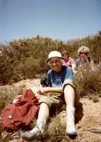 P008.011m.r.t Oakzanita Peak - Cuyamaca 1983: Margaret Lewis sitting for lunch break, Kathleen Gilbraith in the background