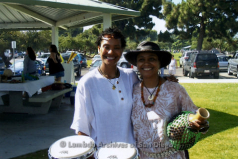San Diego Women's Chorus (SDWC) hosts National Sister Singers Music Festival 2006: 'SDWC' hosts a welcome picnic at Mission Bay Park for the visiting Women's Choirs.  Two women from Druming group arrive with drum and shekere gourd instrument.