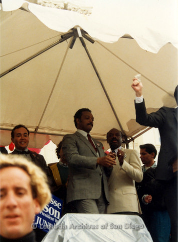 P019.133m.r.t March on Sacramento 1988 / Pre Parade gathering: Jesse Jackson standing on stage in front of City Hall