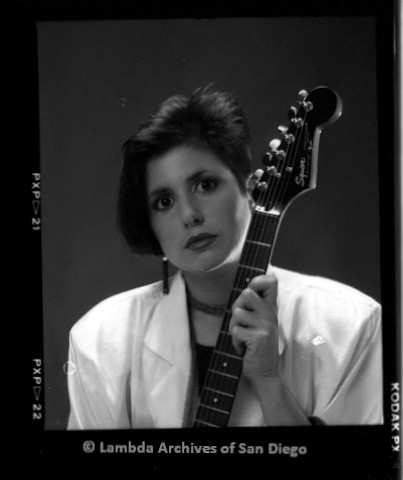 1988 - San Diego Native, Close up of Zanne in white blazer with White Guitar, Studio Portrait.