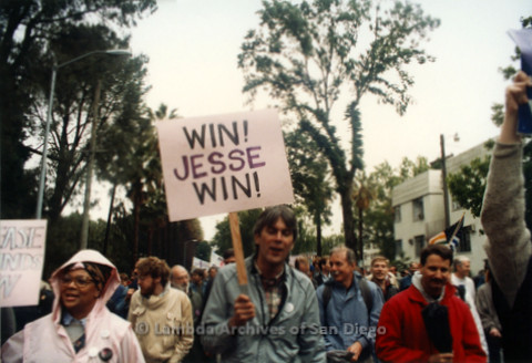 "P019.122m.r.t March on Sacramento 1988 / Parade: Man marching with a sign that reads ""WIN ! JESSE WIN!"""