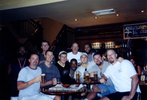 P338.001m.r.t Sydney, Australia trip: Charles McKain (center back) posing with gay basketball team at a bar in Sydney