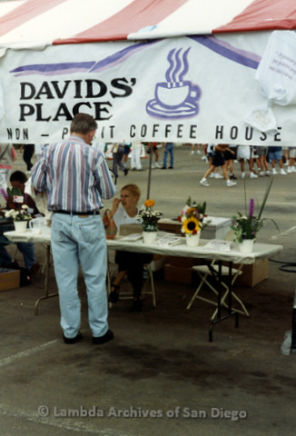 "P240.045m.r.t The Center at AIDS Walk 1994: Man visiting ""David's Place Coffee House Booth."""